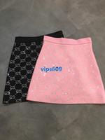pembe siyah etek toptan satış-Kadın kızlar Etek mektup Sıcak sondaj baskı moda Vahşi Yüksek bel kısa Etek Bir Çizgi Mini Etekler siyah Pembe SMLXL