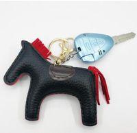 logotipo de couro do keychain venda por atacado-Paris luxo logotipo cavalo Famoso Luxo Feito À Mão PU Couro Cavalo Chaveiro Animal Chaveiro Mulheres Saco Charme Pingente Acessórios