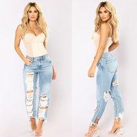 pantalones vaqueros al por mayor-Fashion Holes Out Jeans Mujer Light Color High Loin Whisker Pantalones Tallas grandes