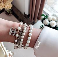 joyería de moda pulsera de perlas al por mayor-Joyas de mujer 2019 moda clásico caliente y elegante de gama alta de encargo de múltiples capas pulsera de perlas