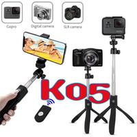 мини удлиняемый монопод оптовых-K05 4 в 1 беспроводной Bluetooth селфи палочка камеры мини штатив выдвижной монопод универсальный для андроид IOS для iphone samsung huawei Gopro