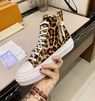 zapatos planos con estampado de leopardo al por mayor-Calzado de mujer de cuero de flor Stellar Hi-top Sneaker Boot Designer Lady Lace-up Leopard Print Canvas Rubber Flat Flat Shoes
