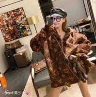 sudaderas de diseño gratis al por mayor-Otoño e invierno Diseño Nueva Parejas chaqueta con capucha de Coral lana gruesa chaqueta acolchada tendencia de la moda de la personalidad de Calle envío