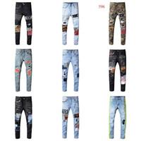 jeans rotos parcheados para hombre al por mayor-Marca Ami diseñador del Mens pantalones vaqueros rasgados jeans ajustados pantalones del motorista Pantera Soldado Hombres dril de algodón delgado del leopardo Parches Nuevo 2019