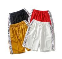 pantalones cortos para hombre relajados al por mayor-Diseñador para hombre Pantalones cortos de verano Pantalones Moda 4 colores letra impresa pantalones cortos con cordón 2019 relajado lujo bermuda pantalones de chándal