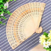 Wholesale chinese wooden carvings for sale - Group buy Chinese Folding Fan Wooden Hand Flower Bamboo home decoration wood carving hollow out fans