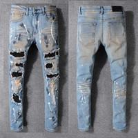 patch jeans marques achat en gros de-Marque jeans célèbre designer mode pantalons AMIRI jeans hommes trou pantalon décontracté patch pantalon pieds pantalon vente chaude pantalon slim 28-40 taille