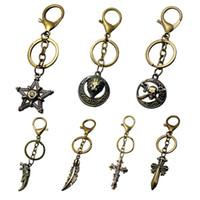 metallwaren großhandel-Manuelle kleine hängende Tropfen-Metallkreuzer Jesus, die Schlüsselschnalle Yiwu-kleiner Warenmarkt leiden