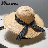 chapéus redondos pretos venda por atacado-2019 elegante aba larga fitas senhoras chapéu de palha praia chapéu de sol para as mulheres viseira ráfia coreano preto Round Top verão panamá
