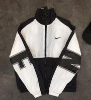 ingrosso giacca nera m-Gli amanti della moda casual degli sport d'oltremare giacca parabrezza amanti degli uomini e delle donne cappotto colore: nero. Taglia: M-XXL
