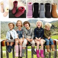 пушистые снежные сапоги оптовых-Australia Ug Snow Boots Детские зимние ботинки Марка Дизайнерские мальчики Девочки пушистые сапоги Уличная теплая обувь Середина икры Полуснежные ботинки 2019 C72910
