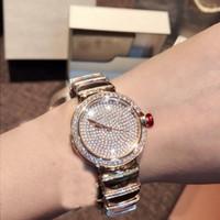 pavimentar relógios venda por atacado-2019 novo 33mm rodada pedra de zircônia cúbica pavimentada relógio de pulso de quartzo de alta qualidade rosa-ouro-cor / prata-cor designer de relógio para as mulheres
