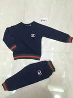 bebek süpermen setleri toptan satış-Erkek kız 2 parça giysi setleri çocuklar tişörtü ve uzun pantolon bebek kız giysileri