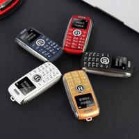 kilitli olmayan cep telefonu toptan satış-Unlocked Mini Araba Anahtar cep telefonları bluetooth MP3 ses değişimi GSM Çift sim kart cep cep telefonu bluetooth dialer cep karikatür ço ...