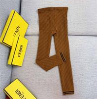 pantalones de skate al por mayor-Nuevo invierno polainas de la manera nueva Carta FF entrelazan Brown polainas medias de las mujeres Negro de punto nueve centavos pantalones pantalones de las medias