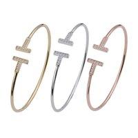 dia de san valentin parejas al por mayor-Marca los hombres y mujeres de la moda de joyería doble en forma de T par de diamantes brazaletes de puño joyas regalo de San Valentín ..