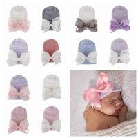 ingrosso ospedale del bambino-12 colori Newborn grande fiocco Cappelli bambino Crochet Knit Caps Infant Skull Beanie inverno caldo a strisce del nastro di Bowknot Tyre Cap Hospital Hat RRA2222