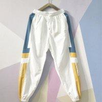 calças padronizadas venda por atacado-Designer Mens Calças de Luxo com Padrão de Painéis Calças Esportivas Com Cordão Casuais Nove Pontos Sweatpants Tamanho Asiático M-4XL
