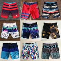 hombre troncos al por mayor-2019 New Man Beach Shorts Todos 88 colores Marcas famosas Cintura elástica Secado rápido Impermeable Simwear Surf Trajes de baño Pantalones cortos Diseñador