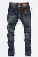 moda motera para hombre al por mayor-2019 nuevos Mens Distressed Ripped Biker Jeans Slim Fit motocicleta Biker Denim para hombre diseñador de moda Hip Hop Jeans para hombre de buena calidad