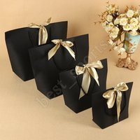 Wholesale xl gift bags resale online - 5 Colors Paper Gift Bag Boutique Clothes Packaging Bags with Bow Ribbon Elegant Cardboard Package Shopping Bags ZZA1419