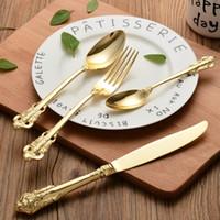 vergoldete messer großhandel-Retro Vintage Western Gold Plated Relief Besteck Essmesser Gabeln Teelöffel Set Golden Luxury Geschirr Geschirr Set 4-tlg