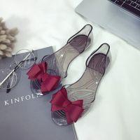 siyah kumaş sandaletler toptan satış-2019 Yaz Yeni Kadın Yay Çiçek Jöle Plaj Rahat Sandalet Çevirme Düz Ayakkabı Moda Temizle Sandalet Kırmızı Siyah Bej