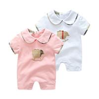 niños bordados al por mayor-2019 nuevos mamelucos bordados para niños manga corta con cuello redondo diseñador recién nacido traje de moda mono ropa
