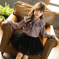 niños coreanos arcos al por mayor-Nuevo 2019 Blusas para niños Camisas de manga larga coreanas Camisa de moda para niños Blusa de lazo para niñas Camisa de encaje para niños de primavera de encaje, # 3795