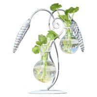 su şişesi sulama sivri uçları toptan satış-Vintage Pirinç Çiçek Spike Yaratıcı Hidroponik Vazo Küçük Taze Yeşil Cam Şişe Su Bitki Konteyner 2 cam şişeler