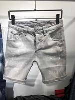 jeans stretch branco venda por atacado-2019 Mens Emblema Rasga Stretch branco Jeans Moda Designer Slim Fit Lavado Motocycle Calças Jeans Painted Hop Hip Calças