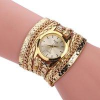hermosas mujeres reloj al por mayor-El oro caliente de la venta Hermoso Reloj Para mujeres de lujo del patrón envolvente pulsera de la serpiente del Rhinestone relojes de cuarzo