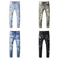 jeans rotos parcheados para hombre al por mayor-Mens pantalones vaqueros de diseño Pantalones Hombre rasgado Hip Hop Jeans Hombre del soldado dril de algodón delgado rectas motorista Brand Jeans Ami motocicleta con parches de diamante
