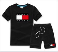 ingrosso 12 18 mesi vestito nero dei ragazzi-T-shirt e pantaloncini di marca per bebè e ragazzi Tute di marca per bambini 2 Abbigliamento per bambini Set T-shirt per bambini T52136