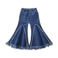 botas de bebé niña caen al por mayor-La niña de la borla de los pantalones vaqueros de empalme de trapo remiendo de Big Boot Cut Wash cepillado de mezclilla pantalones elásticos de cintura Medio pantalones de diseño para niños Fall 1-6T