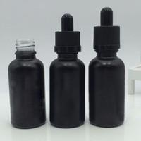 gafas cosméticas negras al por mayor-Al por mayor- 10pcs10ml 30ml E Liquid Bottle Black Frosted Round Shaped Glass Dropper Bottles Essential Oil Container Cosmetic