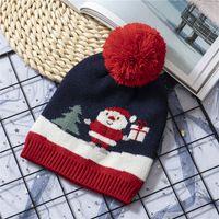 Wholesale kids christmas cap resale online - Christmas Kids Knitting Santa Hat Warm Winter Children Xmas Free Snowflake Beanie Cap Outdoor Baby Ski Caps TTA2021