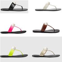 classic Men Beach slippers Summer fashion women Shoes flip-flops 100% leather lady Slippers Metal Flat Ladies slippers Large size 34-42-45