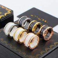 faixas famosas venda por atacado-Preto Branco Cerâmica Whorl Anéis de Prata de Ouro Rosa cores de Metal Titanium aço Inoxidável banda anel famosa marca de moda Jóias Tamanho 5 a 12