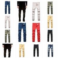 jeans de mujer destruidos al por mayor-Pantalones vaqueros del agujero del viento de high street europeo Hombres destruidos Pantalones vaqueros pies elásticos de hombres y mujeres mezclados por lotes