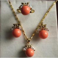 laranja pérola jóias conjuntos venda por atacado-Jewelryr Pérola Conjunto de jóias extravagantes 10mm orange shell pearl, anel, pingente brinco frete grátis