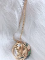 frasco de oro colgante al por mayor-Famoso diseñador clásico de cobre con 18 k chapado en oro doble ronda hueco alfabeto círculo colgante encanto collar para mujer joyería