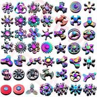 cayro tops toptan satış-Stokta 120 türleri Fidget spinner Gökkuşağı el spinners Tri-Fidget Metal Gyro Ejderha kanatları göz parmak oyuncaklar topaç handspinner witn kutusu