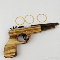 holzpistole kinder großhandel-Neue Kinder Ankunft Spielzeug Holzspielzeugpistole klassische Spielgummi Pistole Bandspielzeugpistolen interessant Kinder Pistolen Spielzeug