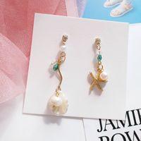 rhinestone encanto de las estrellas de mar al por mayor-Hermosas perlas de estrellas de mar Pendientes asimétricos con forma de broche Clip de concha en pendientes No perforados