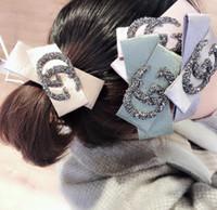 liens de cheveux coréens achat en gros de-2018 cheveux tête corde version féminine coréenne de tissu lettre G strass haute qualité givré anneau cheveux balle à double cravate bande de cheveux gris