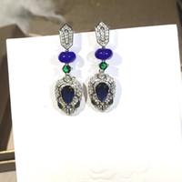 küpeler tasarımcı mavi toptan satış-Mavi taş küpe tasarımcı serpenti uzun çiviler küpe Kadınlar partisi yılan elmas küpe Trendy kristal el yapımı takı
