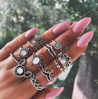 imitação gemstone jóias venda por atacado-Europeus e Americanos personalidade de moda oco em forma de gota de água imitação gemstone crown 12-piece anel comum anel simples jóias