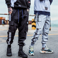 hombres de la calle urbana al por mayor-Pantalones de bolsillo de la moda Pantalones de la moda 2019 Harem Joggers Hombres High Fashion Urban Streetwear Hip Hop Slim Fit pantalones