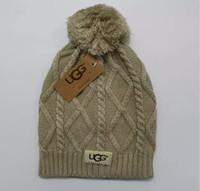 sombreros de invierno de punto de ganchillo al por mayor-Sombrero de punto 2010 Diseñador U t Gorro de punto con pom crochet Gorros de invierno Chunky Cable Caps